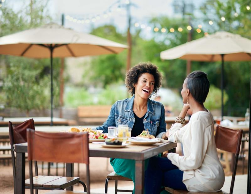 Two women dining on the patio at Contigo restaurant in East Austin Texas