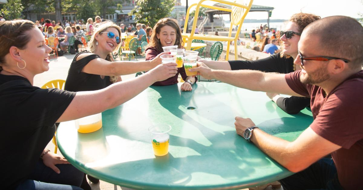 Stroll Down State experience participants toasting at the Memorial Union Terrace in Madison, WI