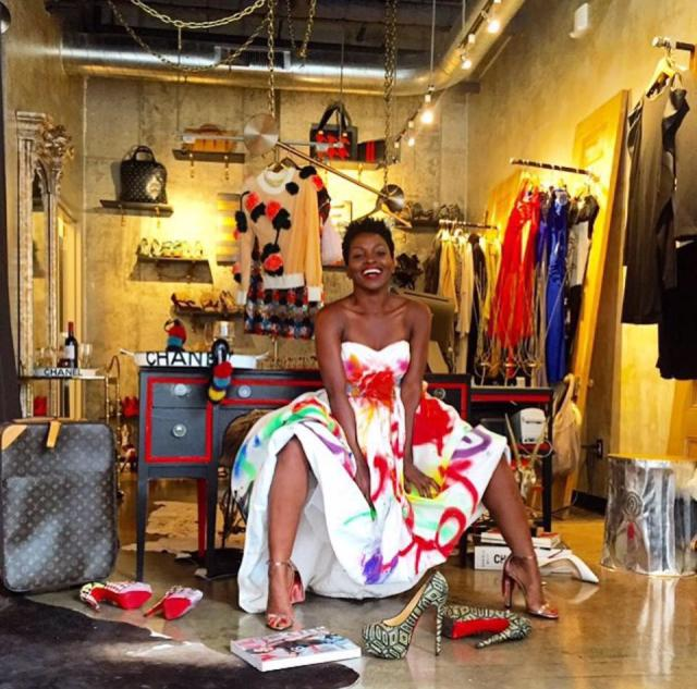 Woman in a colorful dress with shoes and other shopping merchandise