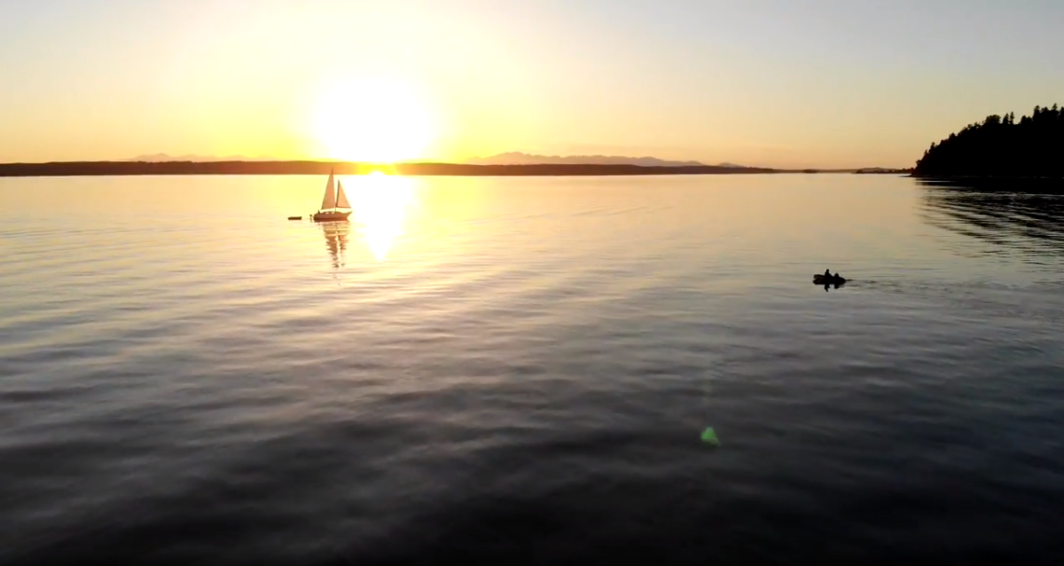 Sailboat on the calm Puget Sound at sunset