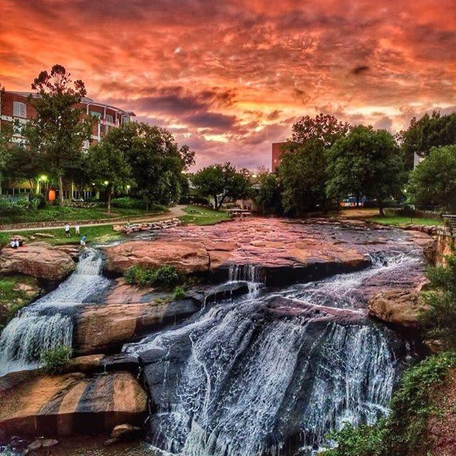 Greenville's downtown masterpiece. #southcarolina #yeahTHATgreenville #sunset #waterfall #skyonfire
