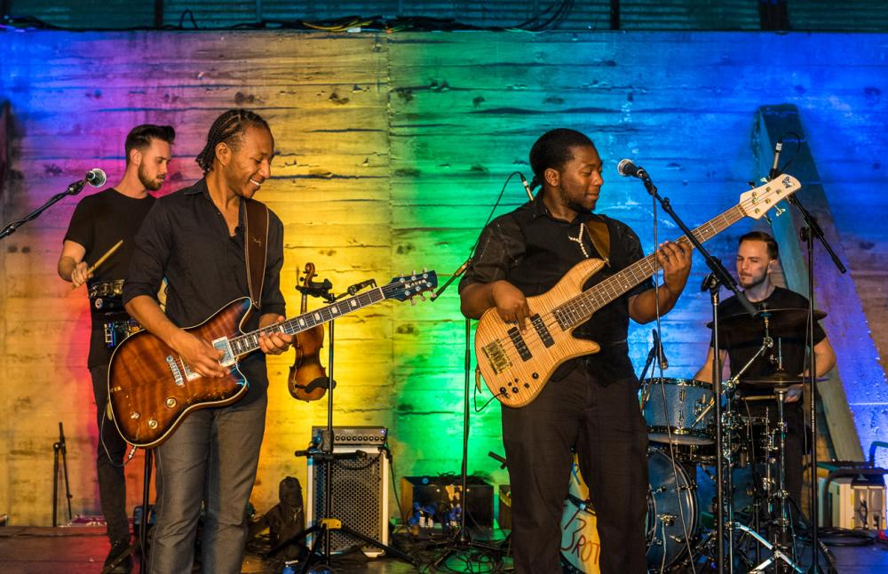 Peterson Brothers perform on stage with guitars