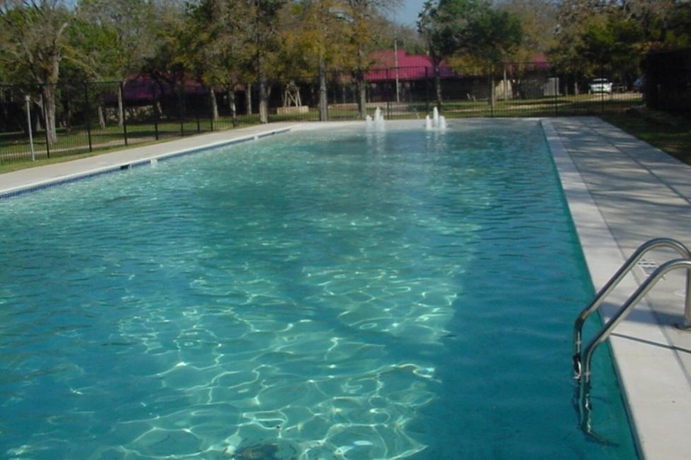 Lower Pool features a beach entry and splash fountains. One of two pools at El Tesoro.