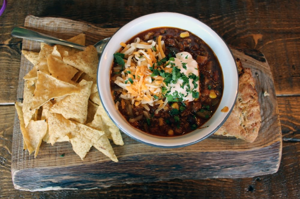 bowl of chili on a wooden board