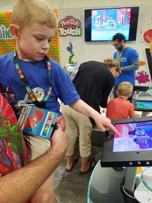 Boy using PlayDoh Touch pad at HASCON in Providence