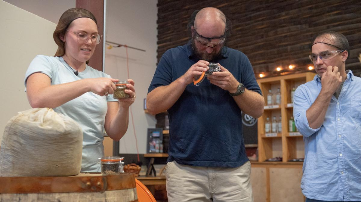 Tour participants sniff grains used to produce Death's Door Spirits