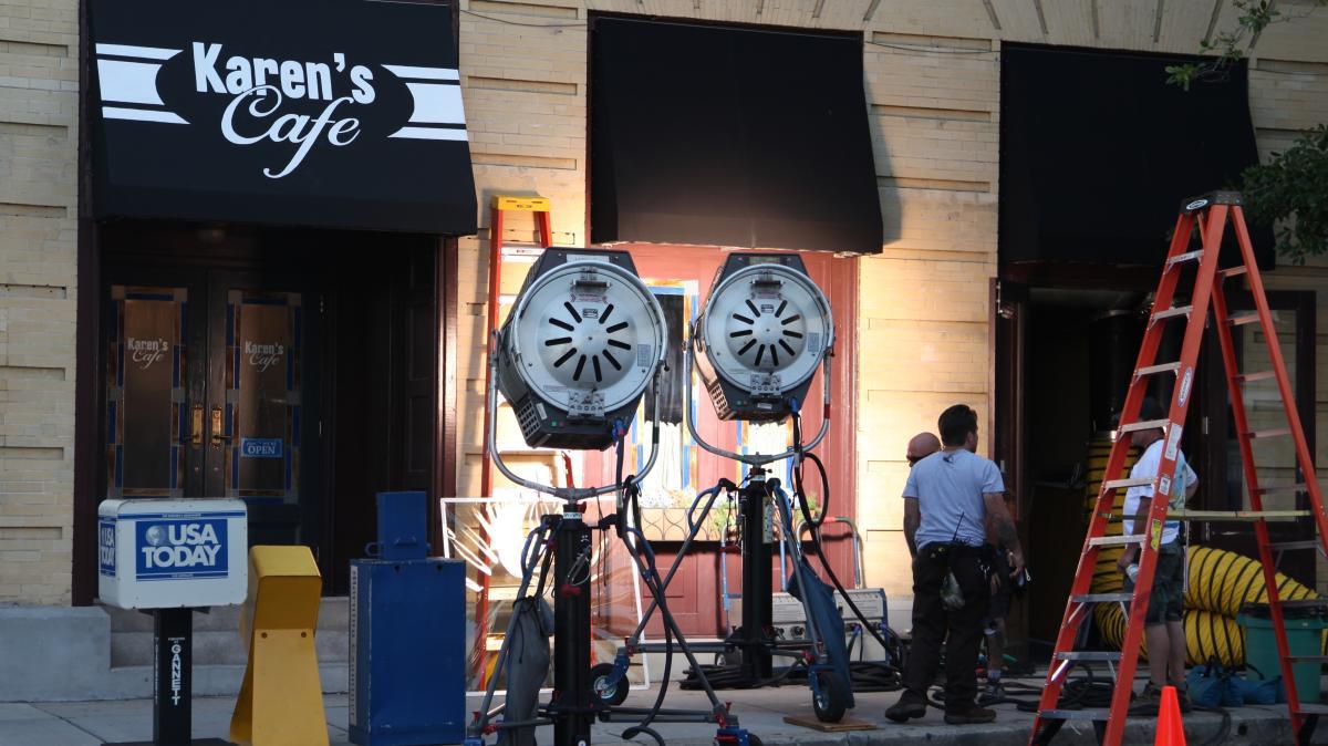Film crew outside set of Karen's Cafe