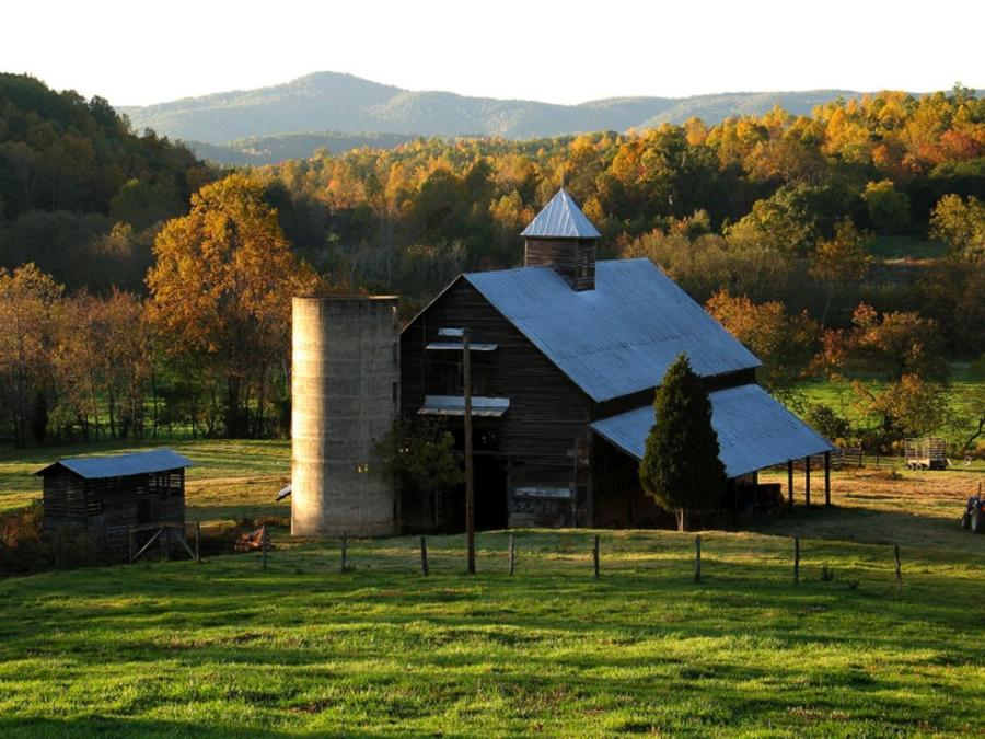 Old fashioned barn surrounded by fall color