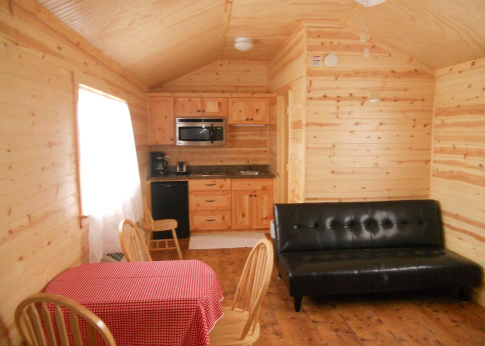 Kitchen and living area of a cabin at Bristol Woodlands Campground