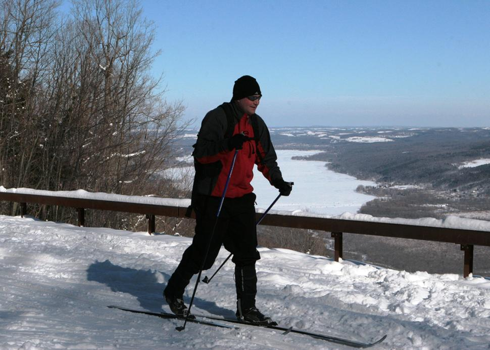 harriet-hollister-state-park-winter-solo-cross-country-skier-passing-overlook-blue-skies