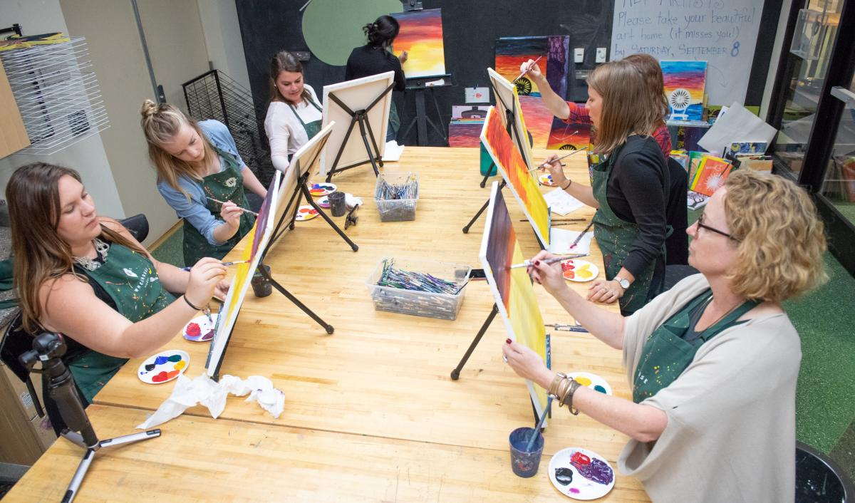 Group of women paint Madison Union Terrace Chairs