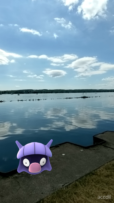 A Shelder from PokemonGO sits on a ledge near the waterfront