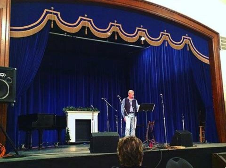 A man performing on stage at the Manitou Opera House