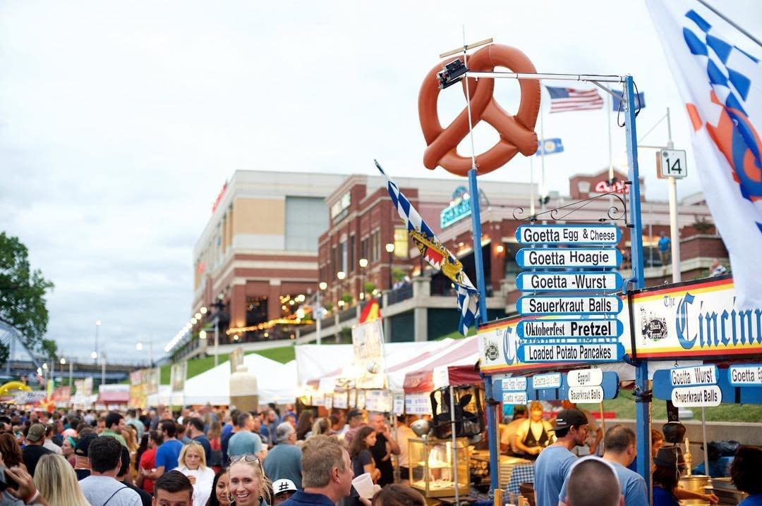 A big crowd at Goettafest at Newport on the Levee with signs hanging above naming goetta dishes