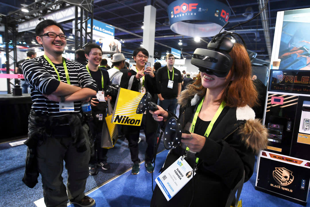 Woman using VR headset at CES