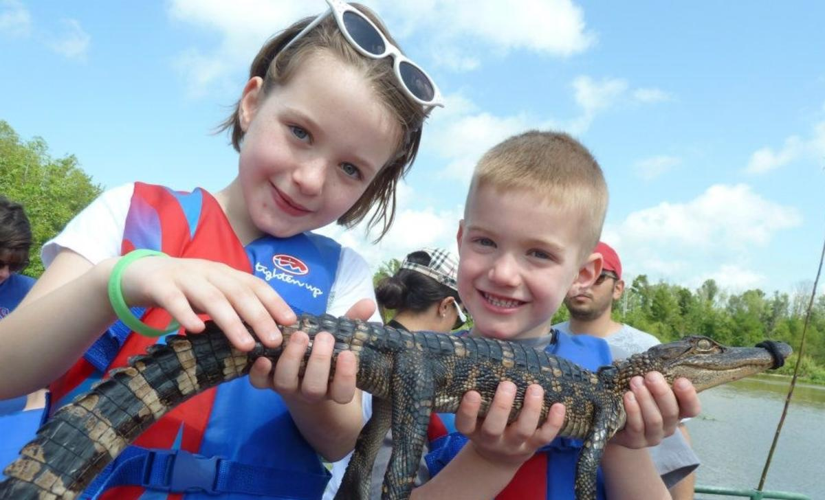 Kids with alligator at Cajun Encounters in Louisiana Northshore