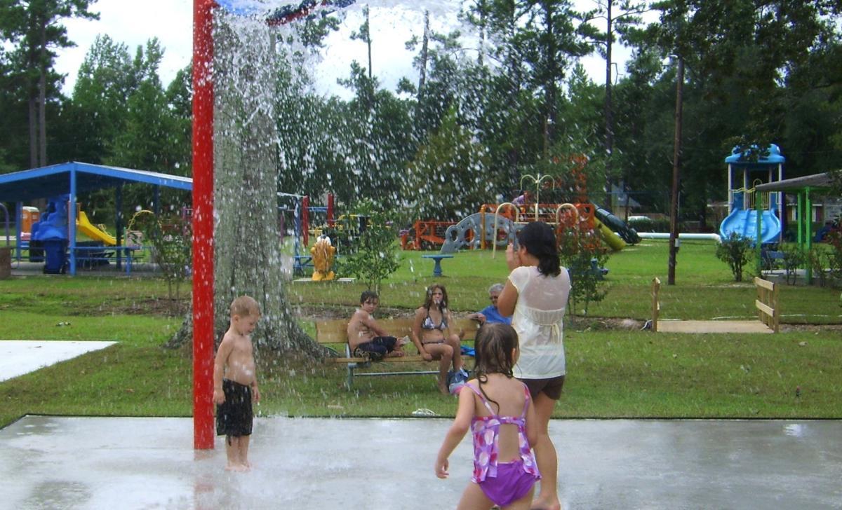 Kids playing under water at Splash Play