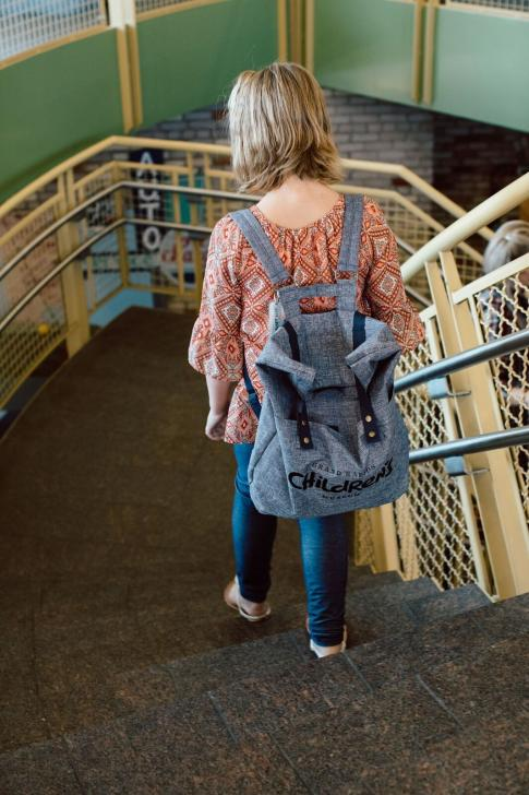 Girl wearing a Grand Rapids Children's Museum Sensory Friendly Tool Kit