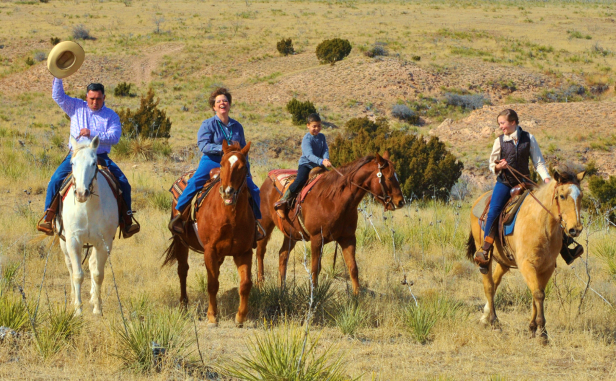 Family riding horses at Cowgirls and Cowboys in the West