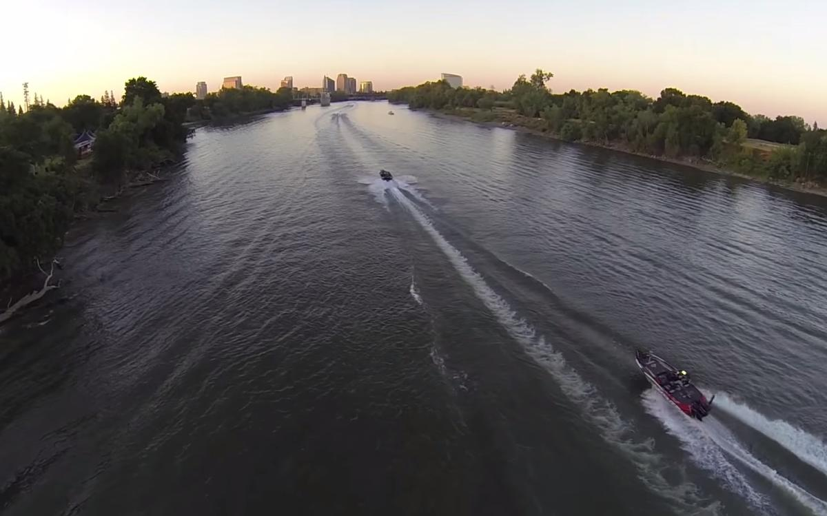 Bass Boats on River with Skyline