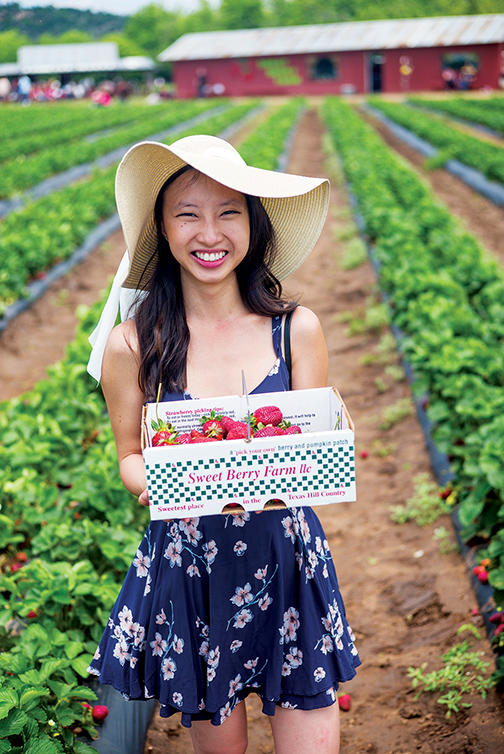 Jane Ko with box of freshly picked strawberries at Sweet Berry Farm