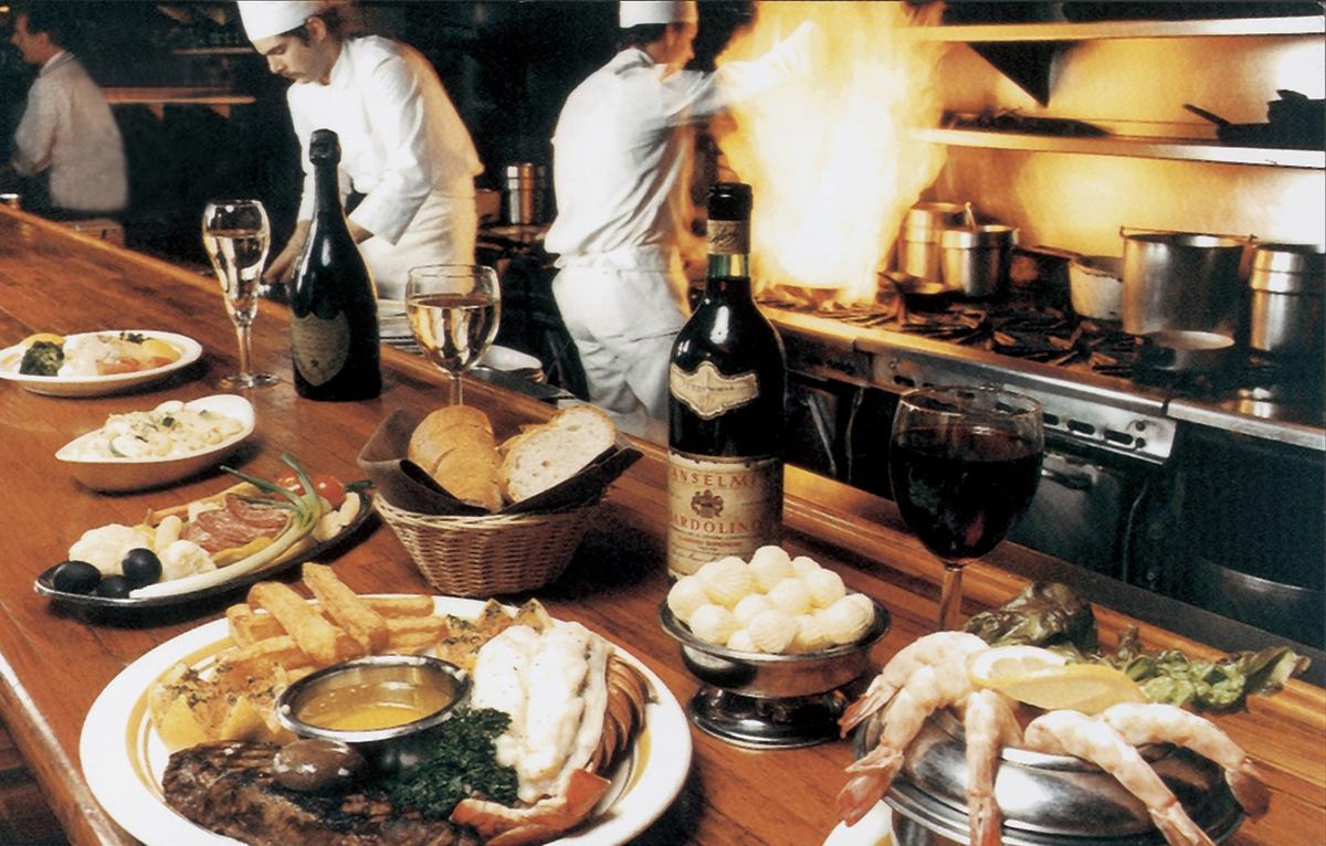13 Coins Kitchen and bar with food being prepared on the stove in the background