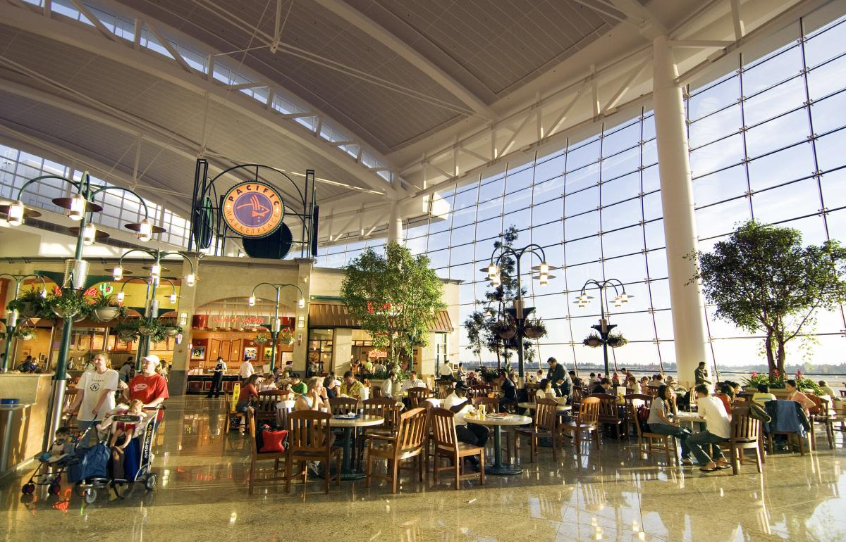 Main Concourse in airport with restaurants and giant window