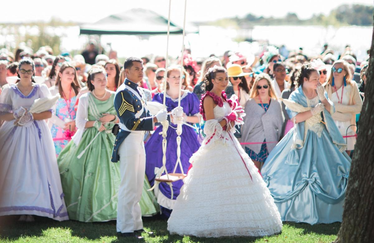 Belles and a soldier by the water at the Azalea Festival