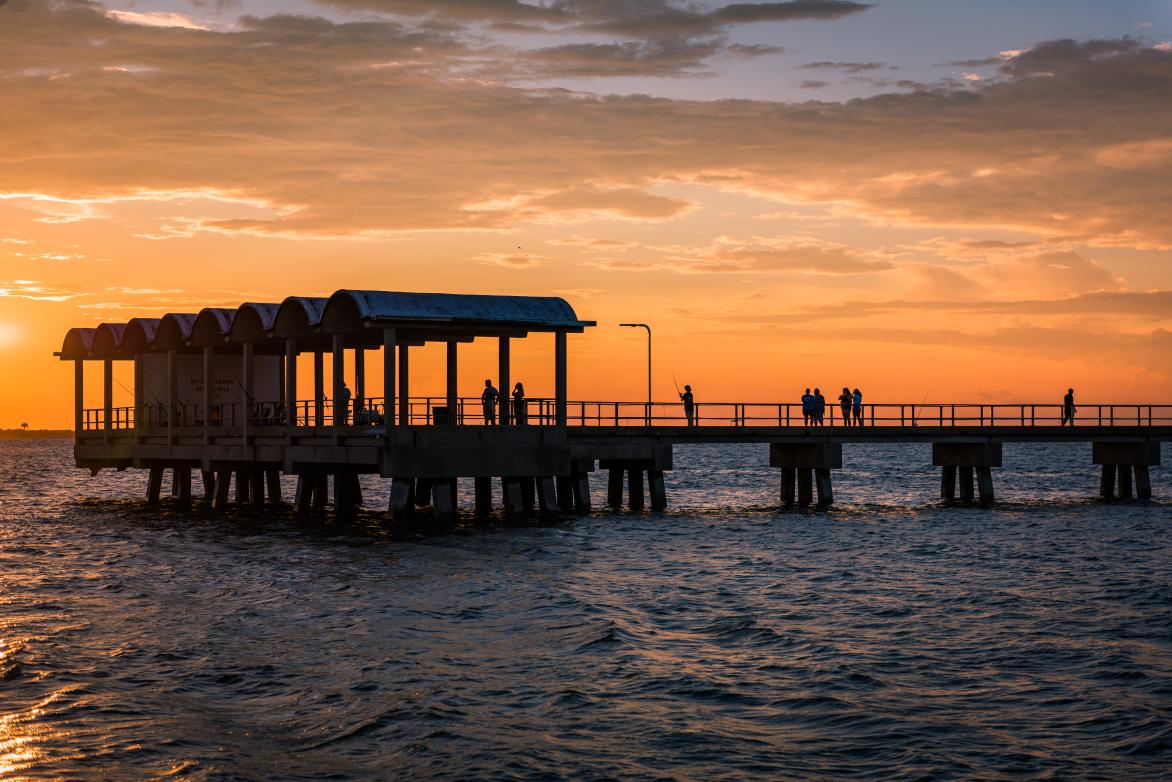 The sun sets behind the popular Jekyll Island Fishing Pier