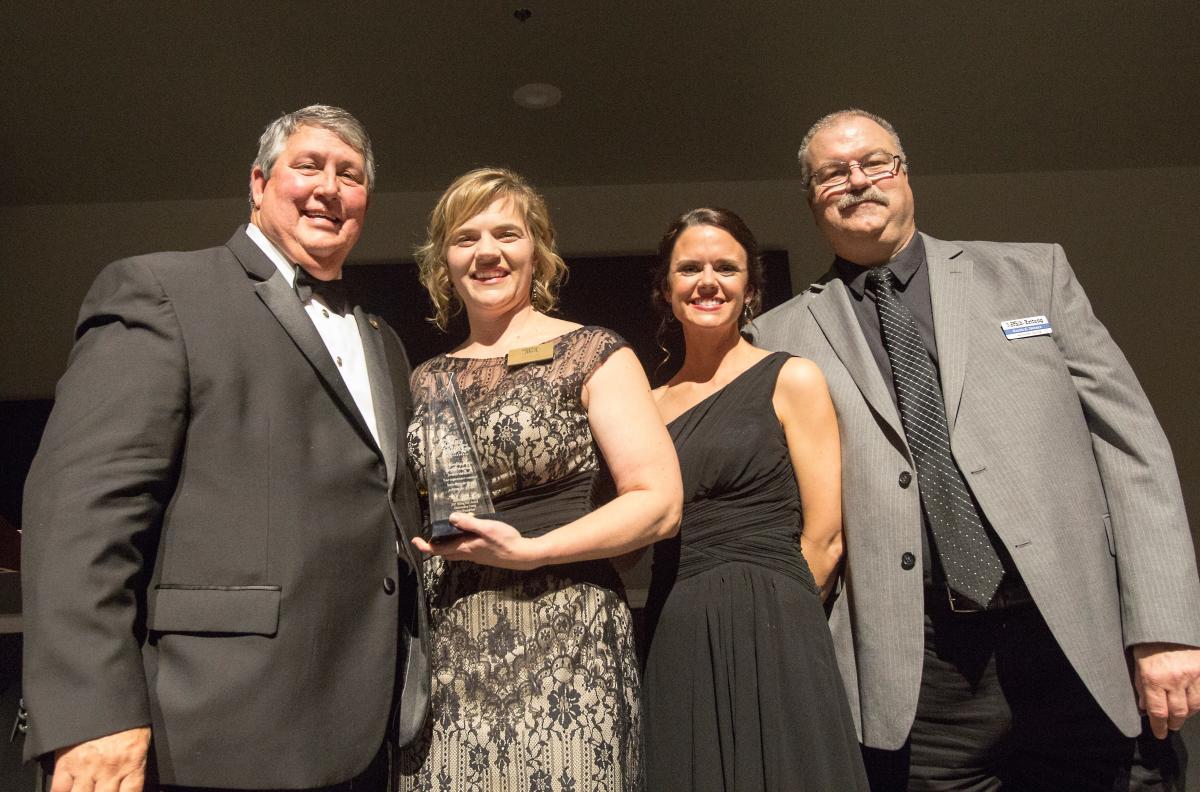 Alice-Jewell receiving an award