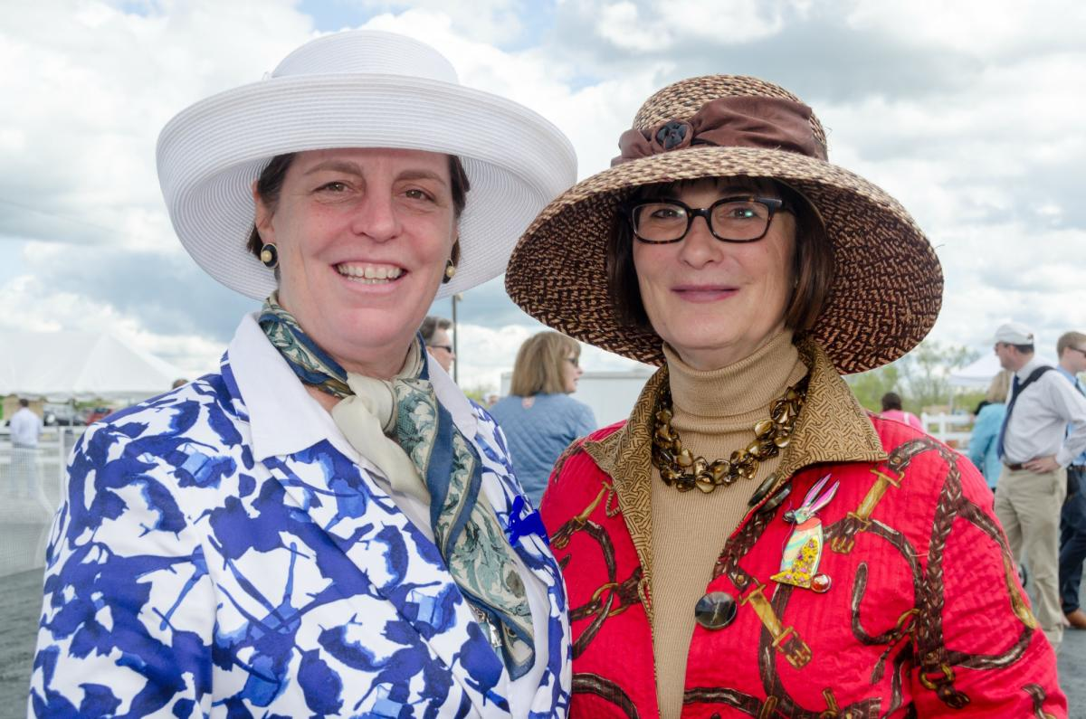 Ladies in fancy hat enjoy some horse racing in Howard County Maryland