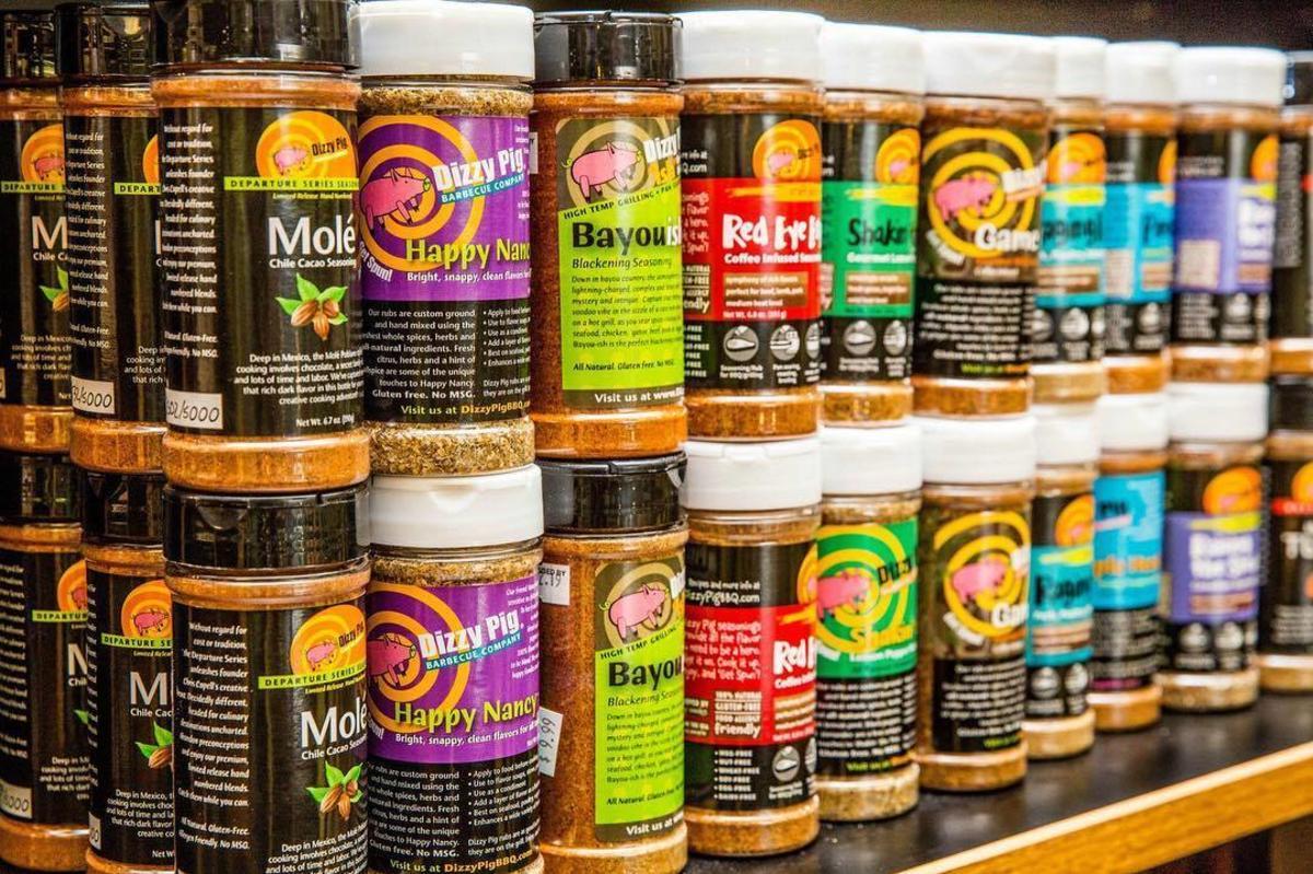 a variety of Dizzy Pig spices on a shelf