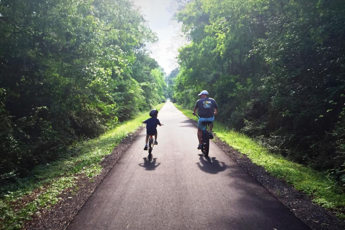 Father and Son Cycling the Tammany Trace