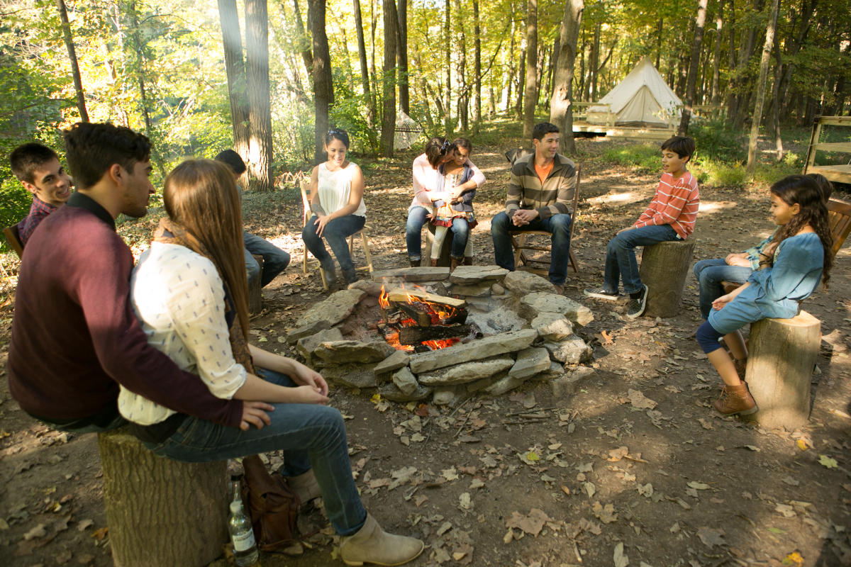 Gather with friends and family by the camp fire