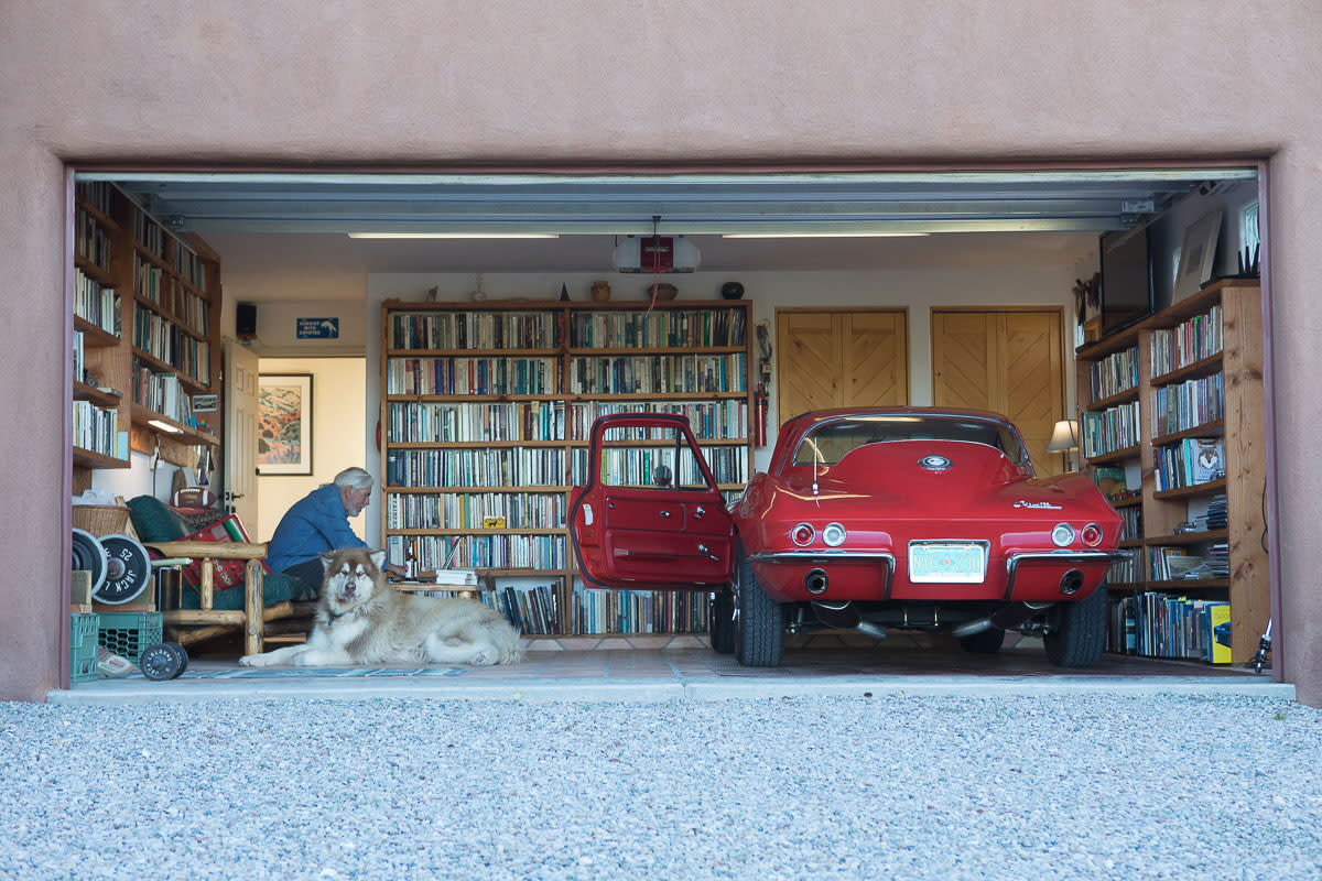 Flores' garage holds two kinds of treasures: book-laden shelves and a little red Corvette.