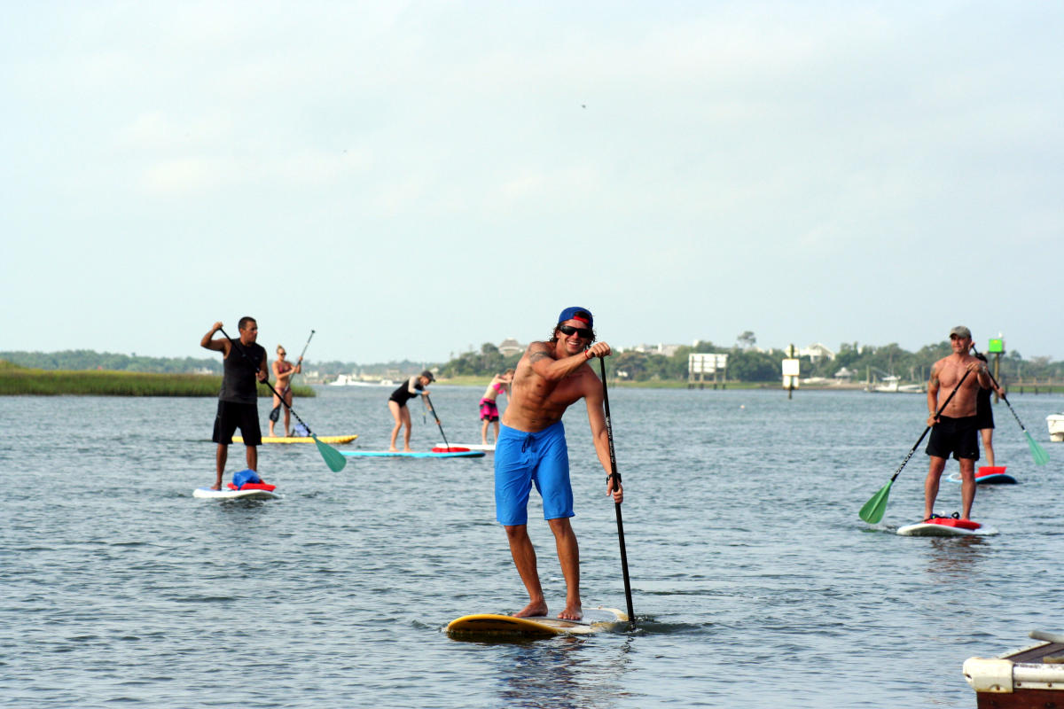 Instructor leads stand up paddleboarders in Wrightsville Beach