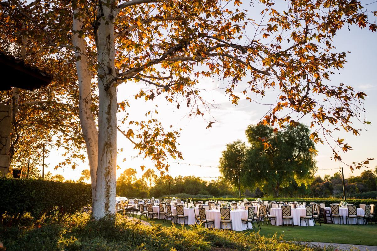 Sun setting over an outdoor wedding reception at Oak Creek Golf Club in Irvine, CA