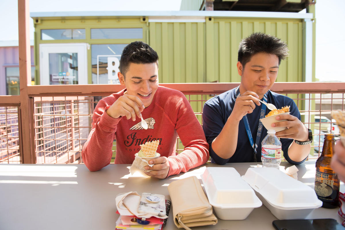 Boys enjoying Nitro Fog's ice cream on the patio at Green Jeans