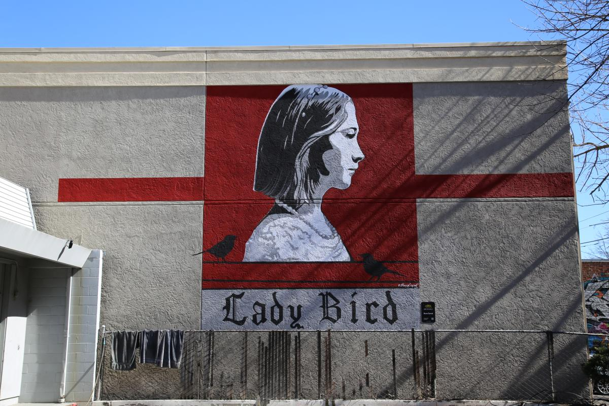 Mural by local Sacramento artist Maren Conrad painted on the side of Visit Sacramento's building.