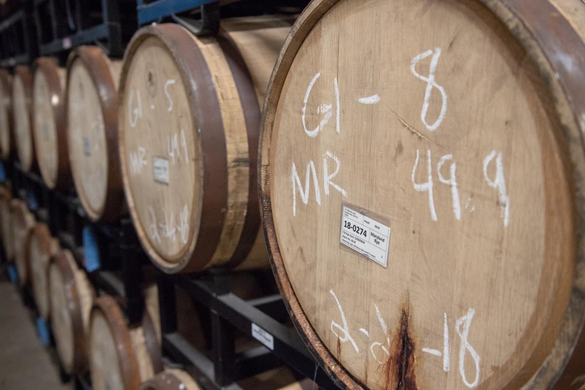 Barrels of spirits sit inside of Death's Door Distillery