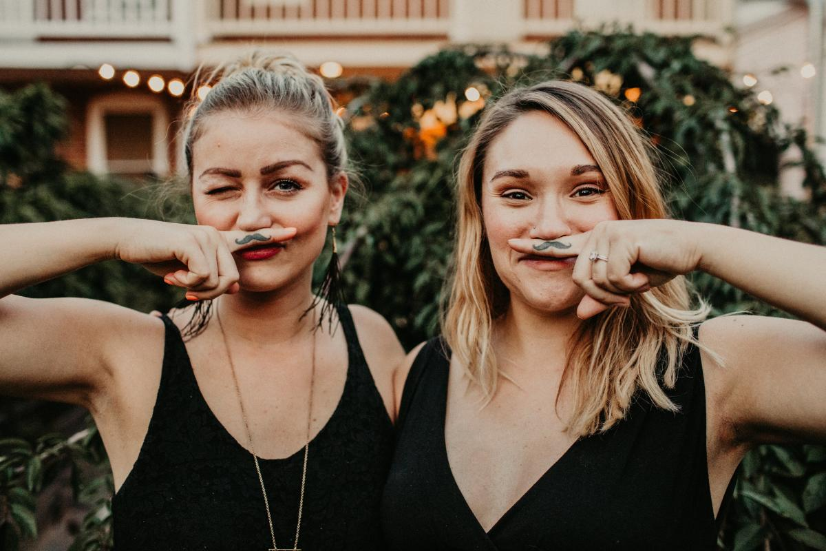 Sarah and Sando of Mustache Mesa with finger mustaches