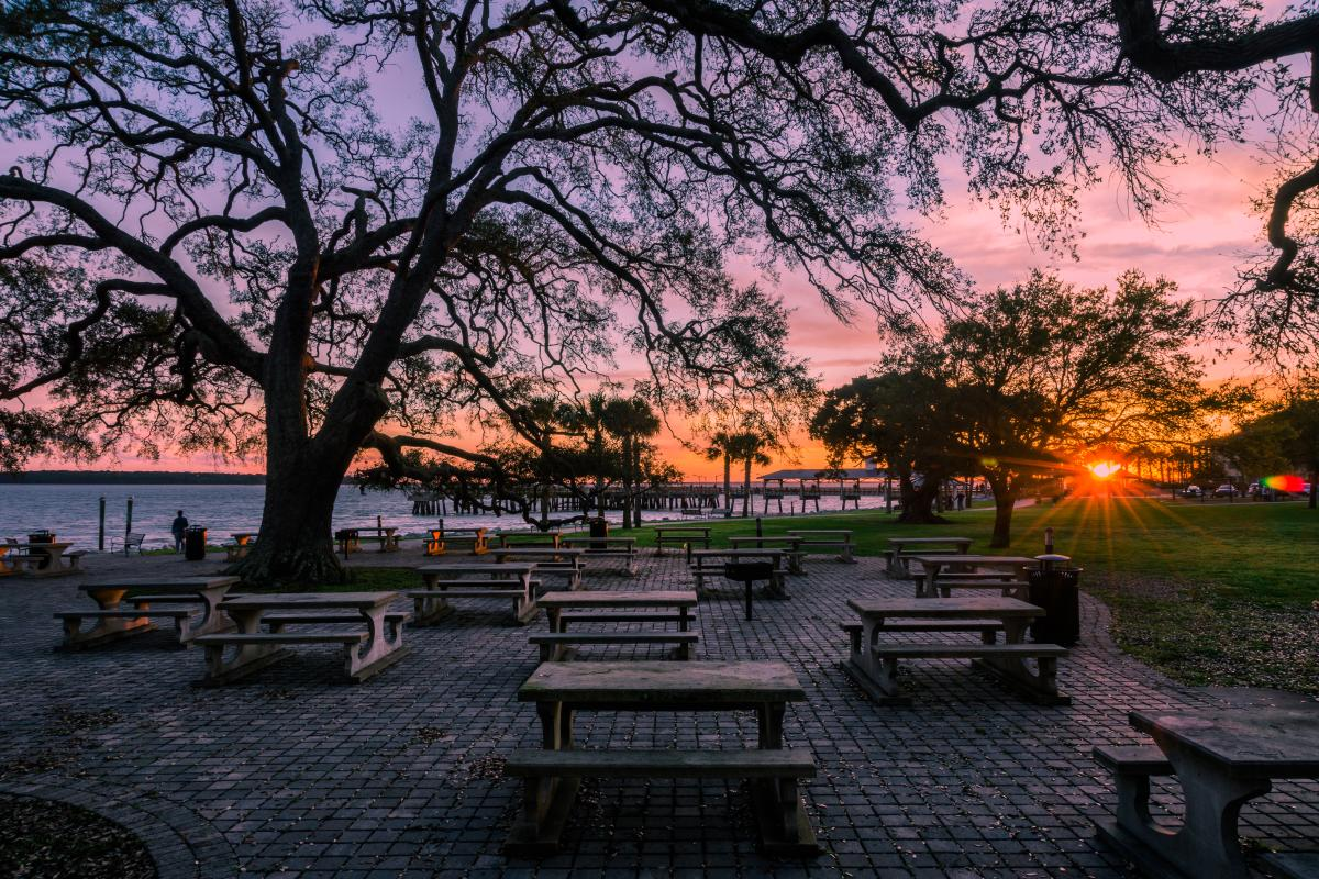 The sunsets behind the Neptune Park picnic area, an oceanfront public park on St. Simons Island, Georgia