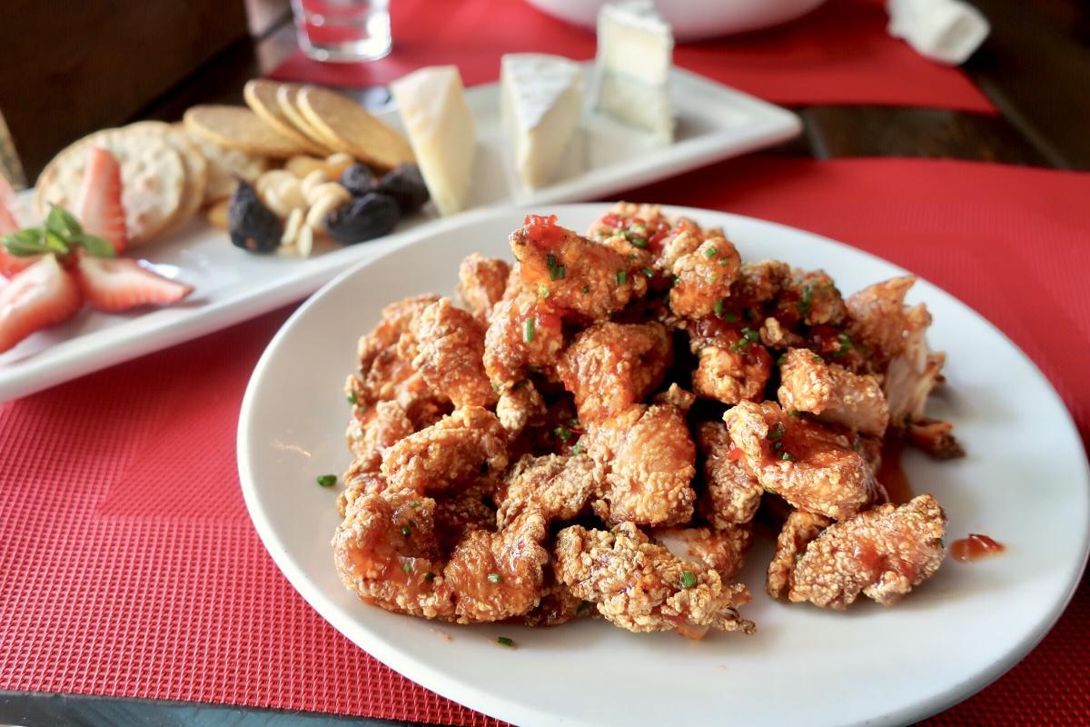 Plate full of golden crisp chicken from Chicken Ranch.