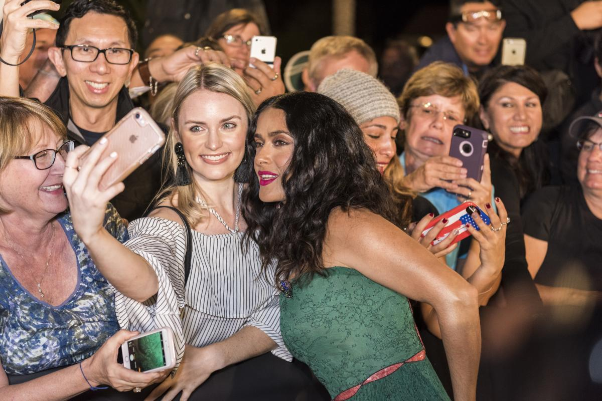 Celebrities greet fans outside of the Palm Springs Convention Center