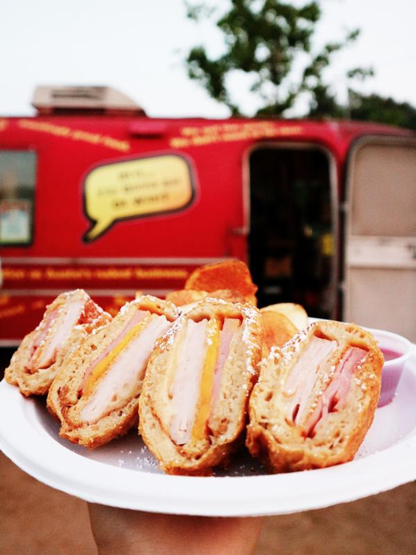 Sandwich slices in front of the Hey You Gonna Eat or What trailer at The Picnic food truck park