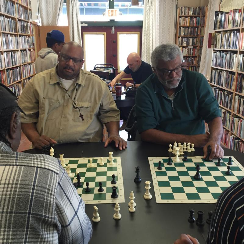 Midtown Scholar Bookstore - Interior - Men playing chess - Mackenzie Carpenter - Oct. 2015