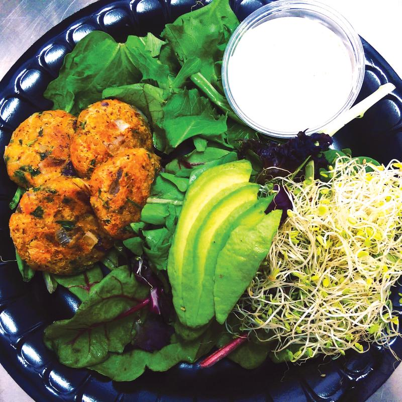 Plate filled with healthy greens, avocado and sprouts