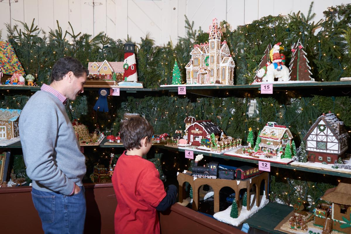 Families enjoy the Gingerbread House display at Peddler's Village.
