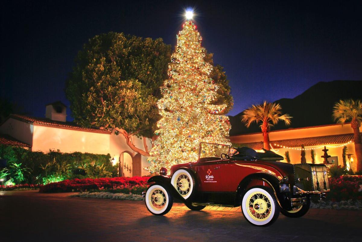 photo of a 1940s red car in front of a lit Christmas tree at The La Quinta Resort