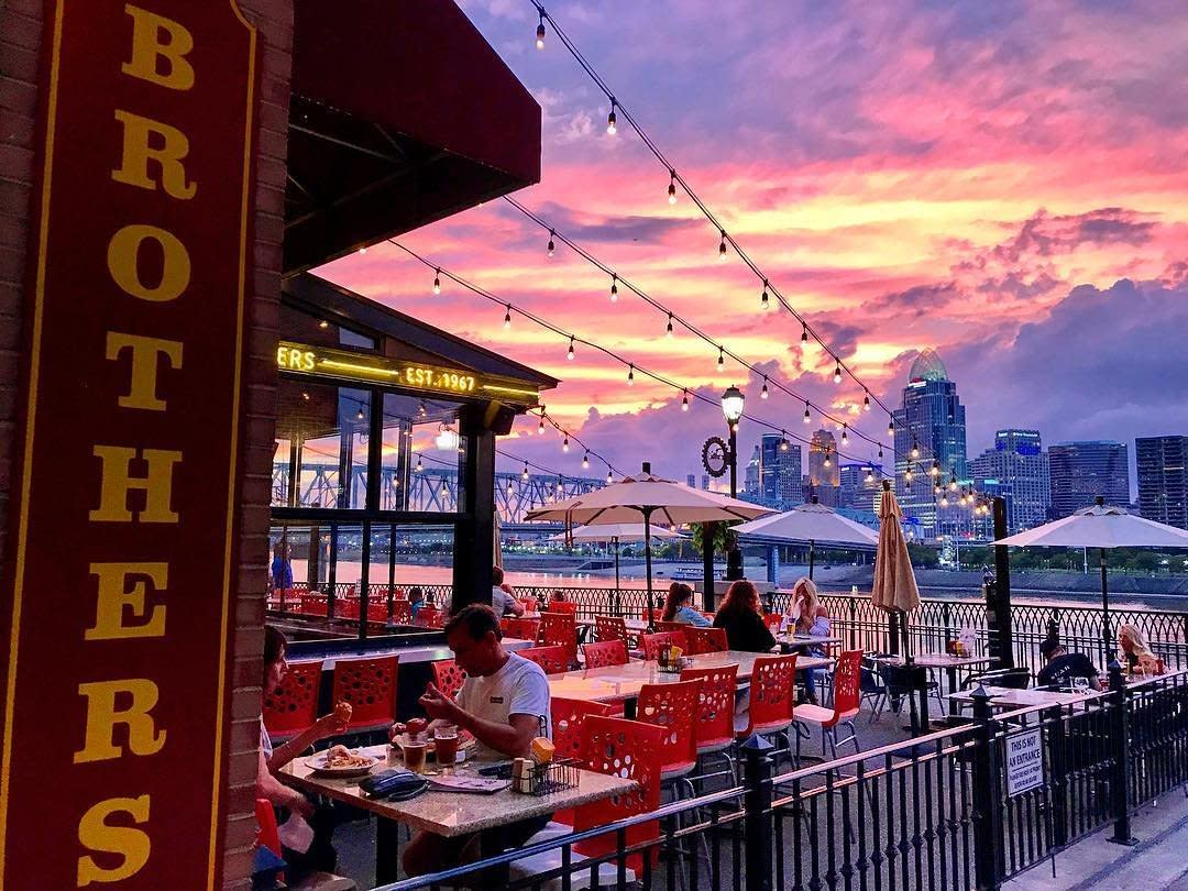 Pink and purple sunset over Cincinnati Skyline, seen from Brothers restaurant in Newport KY